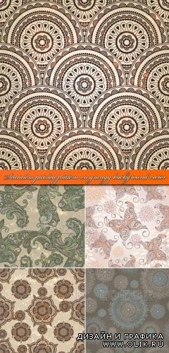 Бесшовные фоны в стиле гранж | Seamless paisley pattern on grungy background vector