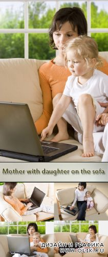 Stock Photo: Mother with daughter on the sofa