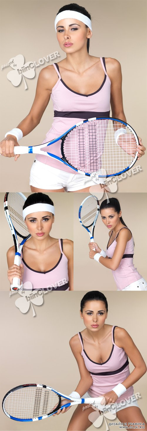 Woman with tennis racquet in her hands 0412