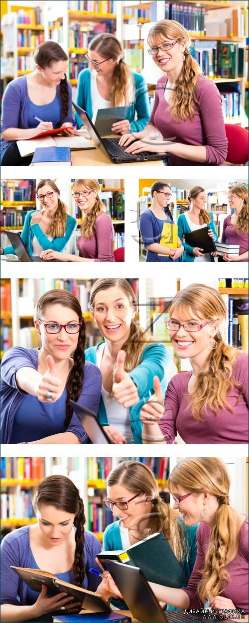 Students reading books in the library - stock photo