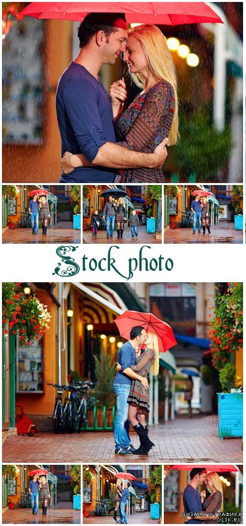 Couple with red umbrella - stock photo