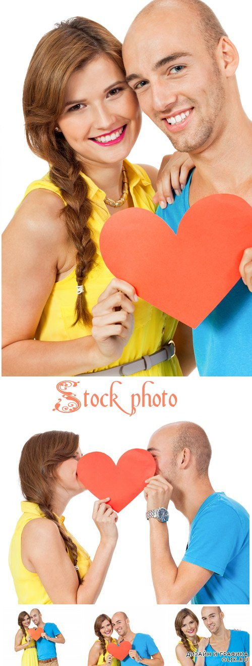Couple with decorative red heart at Valentines Day - stock photo