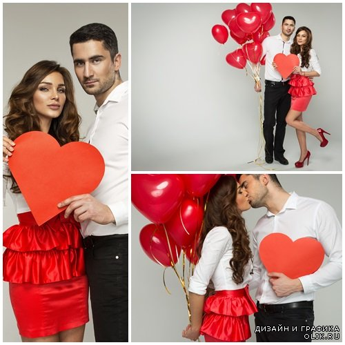 Young couple with ballon hearts - stock photo