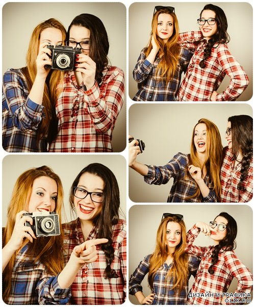Funny hipster girls taking pictures with an old camera - Stock Photo