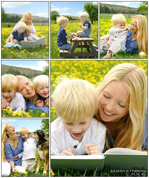 Happy Mother and Child Reading Book Outside in Meadow - Stock Photo