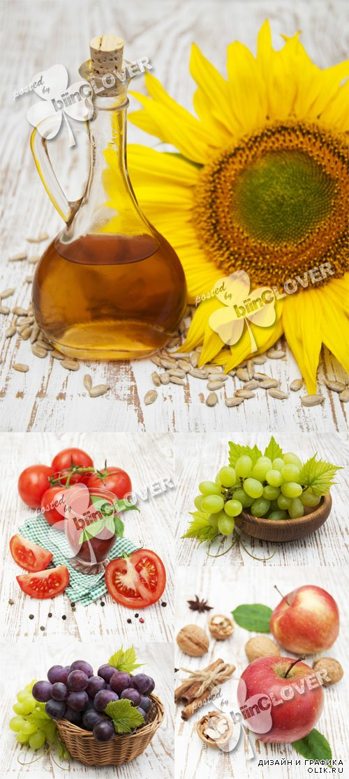 Still life with sunflowers, sunflower oil, grapes, apples and tomatoes on a wooden background 0598