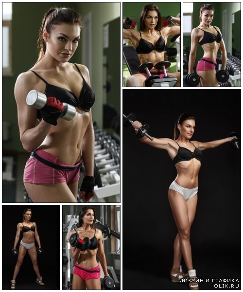Woman bodybuilder training with dumbbell - Stock Photo
