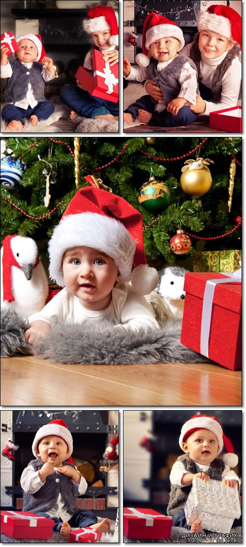 Little boy in Santa Claus hat, near camin - Stock photo