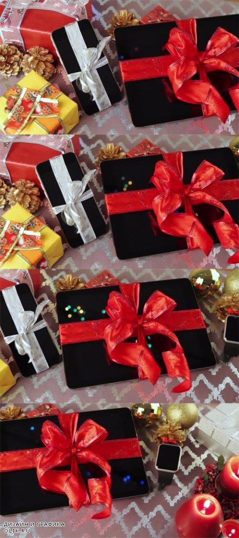 HD Footage - Tablet pc, smartphone and smartwatch for Christmas with gifts, decorations and candles on table