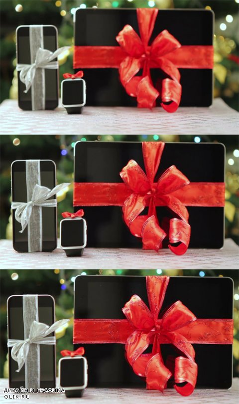 HD Footage - Tablet pc, smartphone and smartwatch as gifts in front of Christmas tree with lights
