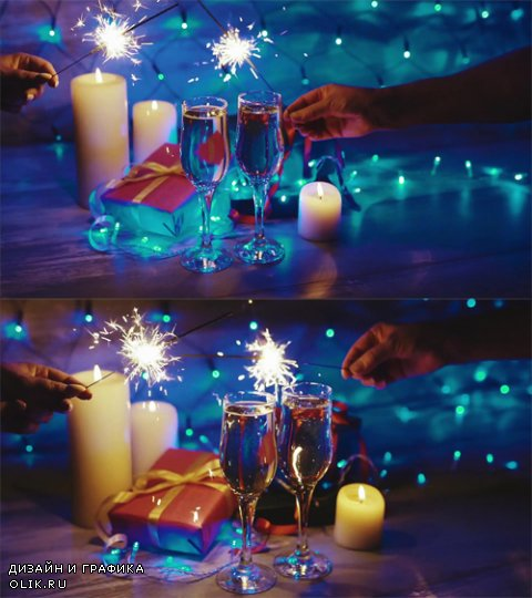 HD Footage - Hands with sparklers on the background of the Christmas decor, candles, gifts and glasses of champagne